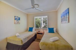 A bed or beds in a room at Coco Bay Resort