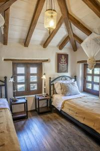 Ένα ή περισσότερα κρεβάτια σε δωμάτιο στο Pelion Homes