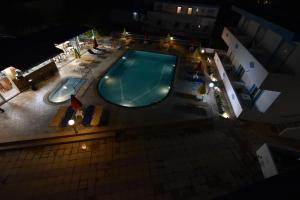 A view of the pool at Villa Popi Studios or nearby