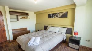 Cama o camas de una habitación en Torre Blanca Apartament Cusco