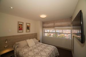 Cama o camas de una habitación en KECHUASRESIDENCE