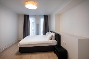 Lova arba lovos apgyvendinimo įstaigoje Biplan ApartHotel