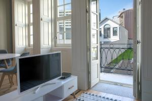 A television and/or entertainment center at Sete Domus Pool & Garden Suites