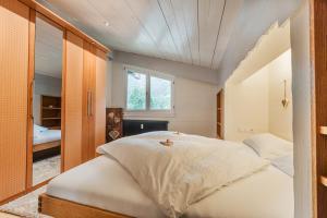 Ein Bett oder Betten in einem Zimmer der Unterkunft Ferienwohnung Kuster