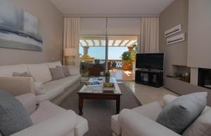 A seating area at 18166 - SUPERB FRONT LINE LOCATION - HEATED POOL