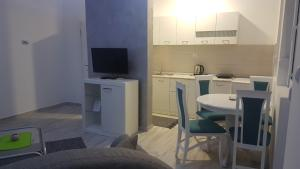 A television and/or entertainment center at Airport view Apartment