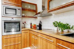 A kitchen or kitchenette at Exclusive City Center 19th Century Apartment