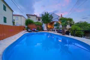 The swimming pool at or near Holiday Home Traum