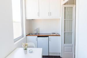 A kitchen or kitchenette at Home Made Guest Studios