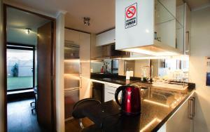 Una cocina o zona de cocina en Departamento Lyon & Once