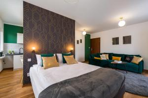 A bed or beds in a room at Sleepway Apartments - Green Dream