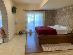 A bed or beds in a room at Toula's Apartments
