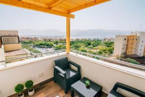 A balcony or terrace at The suite