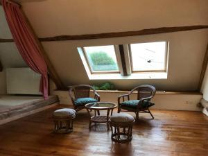 A seating area at La maison gîte (Accous 64)