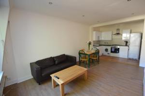 Area soggiorno di Central Comfort Apartments