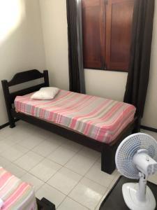 Cama o camas de una habitación en Casas Aracaju Temporada