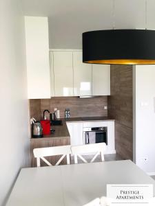A kitchen or kitchenette at Exclusive Apartment
