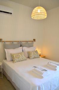 Un ou plusieurs lits dans un hébergement de l'établissement Casa MaLu Boutique Apartments - No 2