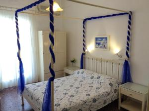 Ένα ή περισσότερα κρεβάτια σε δωμάτιο στο Hotel Elizabeth