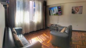 Zona de estar de Del Niño Apartament. En pareja