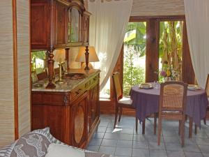 A kitchen or kitchenette at Holiday Home La Tour