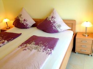Ein Bett oder Betten in einem Zimmer der Unterkunft Comfort Apartments