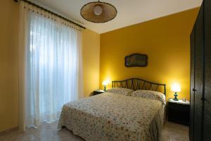מיטה או מיטות בחדר ב-Villetta indipendente vicina al mare