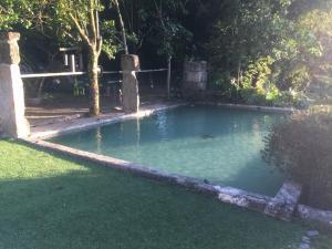 The swimming pool at or near Casa Magnólia