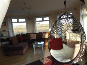 A seating area at Balranald Cottage