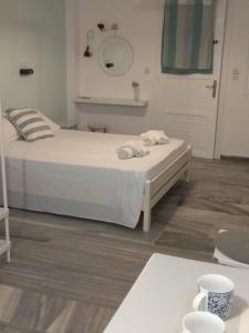 Ένα ή περισσότερα κρεβάτια σε δωμάτιο στο Alex