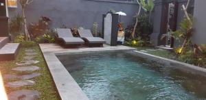 The swimming pool at or close to Pondok Buda Merta 2