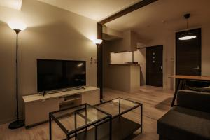 A television and/or entertainment center at H2O Stay Bentencho