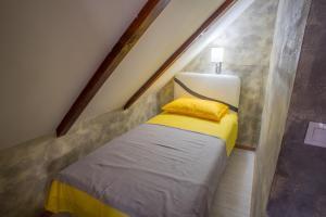 Un ou plusieurs lits dans un hébergement de l'établissement Apartman Restoran Durmitor