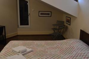 Un ou plusieurs lits dans un hébergement de l'établissement Apartments Qualitas