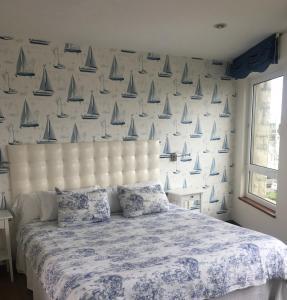 A bed or beds in a room at Apartamentos El Caserio