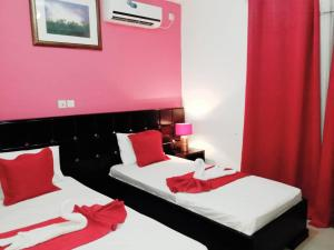 A bed or beds in a room at New Land Sarl