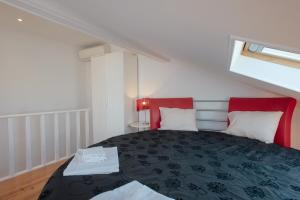 Un ou plusieurs lits dans un hébergement de l'établissement Mouraria Duplex