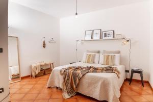 Cama ou camas em um quarto em I Balconi di San Domenico