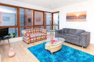 A seating area at Pilot Street apartment at City Quays