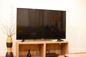 A television and/or entertainment center at Once Upon a Tide Beach House