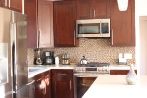 A kitchen or kitchenette at Once Upon a Tide Beach House