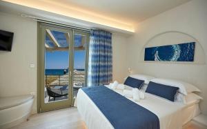 Ένα ή περισσότερα κρεβάτια σε δωμάτιο στο Sunrise Pelion Sea View Villas