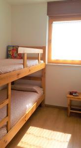 Ein Etagenbett oder Etagenbetten in einem Zimmer der Unterkunft Holiday Home Slavica