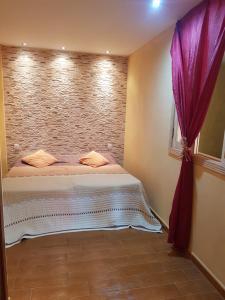 Een bed of bedden in een kamer bij Villa Las Salineras