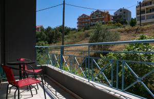 A balcony or terrace at Colourful apartments (Red passion)