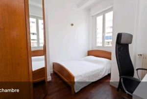 A bed or beds in a room at Sea view - NICE - Promenade des anglais - 100m2 - 3 bedrooms - 6 persons - Standing