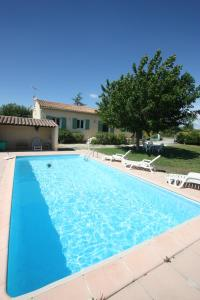 The swimming pool at or close to Les Papillons