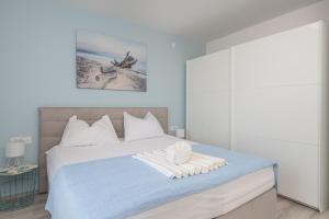 Postel nebo postele na pokoji v ubytování Apartments Lidija