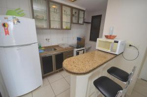 A kitchen or kitchenette at Leme Penthouse Apartment
