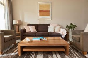 A seating area at Sea Change Beachfront Apartments